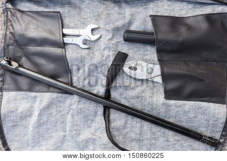 Top view of unfold black leather bag of toolkit for general fixing