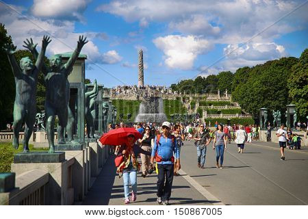 EDITORIAL OSLO NORWAY - AUGUST 18 2016: Many tourist walk Vigeland Sculptures Park in the popular Vigeland park ( Frogner Park ) designed by Gustav Vigeland in Oslo Norway on August 18 2016.