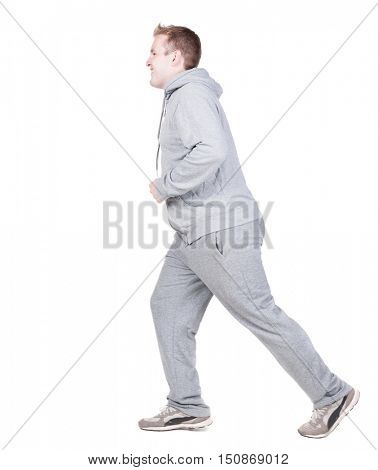 back view of running athlete man in tracksiut . walking sportsman in motion. Rear view people collection.  backside view of person. Isolated over white background.