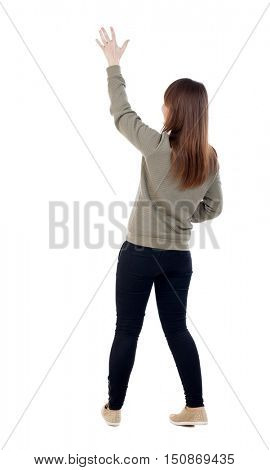 Back view of beautiful woman welcomes. Young teenager girl in dress hand waving from. Rear view  people collection.  backside view of person.  Isolated over white background. A girl in a gray jacket
