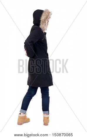 Back view woman in winter jacket  looking up.   Standing young girl in parka. Rear view people collection.  backside view of person.  Isolated over white background.