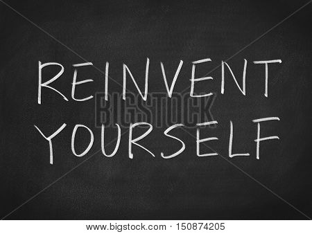 Reinvent yourself. words text on blackboard background