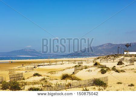 Miles of white sandy beaches of the Atlantic shore at Spanish coast of Playa De Los Lances in Tarifa, Spain.