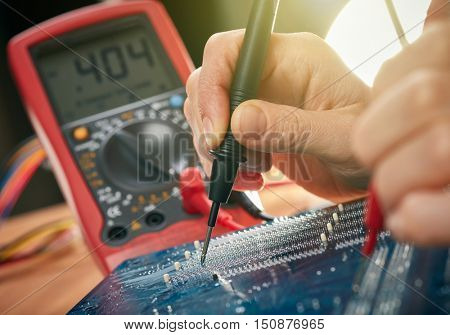 Technician repair motherboard. Technological background