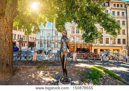Geneva, Switzerland - June 23, 2016: A statue of a naked, emaciated, melancholy young woman named Clementine in the old town of Geneva. The statue was created by Swiss sculptor named Heinz Schwarz