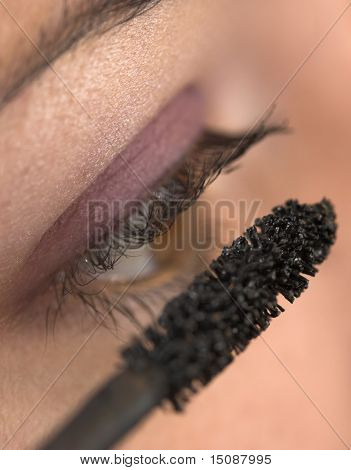Closeup of a young beauty applying makeup.