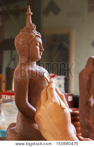 A Modeler Molding Clay Model of Buddha