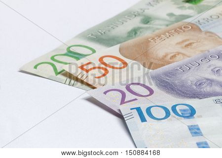 Swedish currency 20 50 100 200 SEK new layout 2016 laying on a table. Short depth of focus