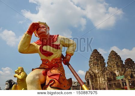 Lopburi Thailand December 7, 2014 Sun Wukong statue of magic monkey in front of three stupa temple