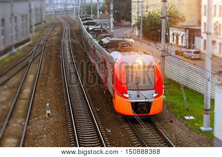 Modern electric locomotive pulling a high-speed train on rails. Technical railway depot on autumn morning in fog. Transport infrastructure of railways route St. Petersburg - Moscow Russia
