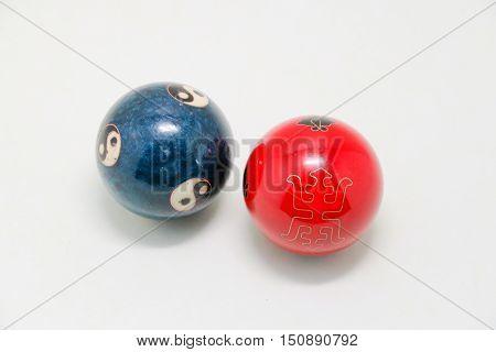 Chinese Zen Balls. Yin Yang Balls, Chinese zen balls red and blue. Chinese zen balls isolated on white. Two Chinese zen balls yin and yang