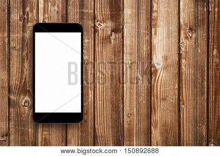 Smartphone with blank screen on wooden table