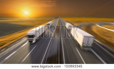 Temperature controlled reefer trucks driving towards the sun. Fast blurred motion image on the freeway at beautiful sunset. Freight scene on the motorway near Belgrade Serbia.