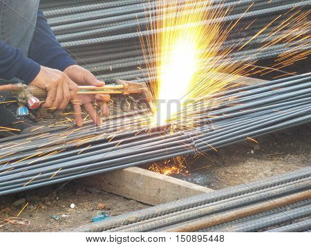 A cutting torch to cut rebar in construction place