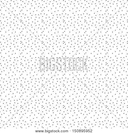 Vector seamless pattern. Modern trendy texture with chaotically repeating small triangles. Random chaotic mosaic. Memphis style