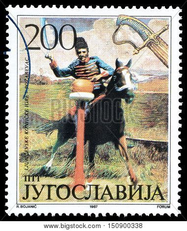 YUGOSLAVIA - CIRCA 1987 : Cancelled postage stamp printed by Yugoslavia, that shows Traditional games in Ljubicevo.