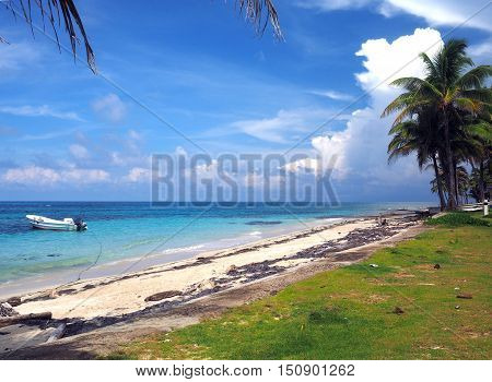 Sally Peachie Beach Big Corn Island Nicaragua Central America with fishing panga boat in Caribbean Sea