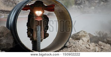 A motorcyclist passes through the tube, the motocross racing