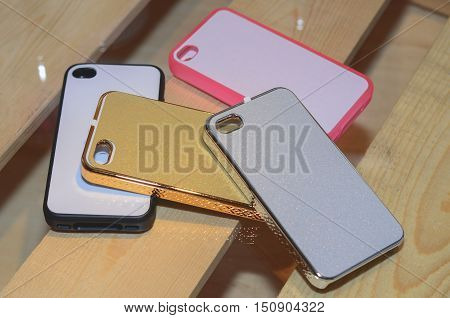 plastic mobile phone cases on a wood background