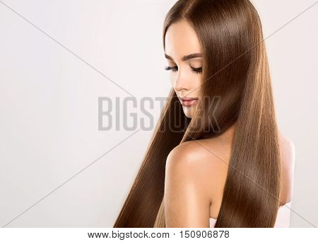 Beautiful model woman with long , straight , healthy and shiny black hair.