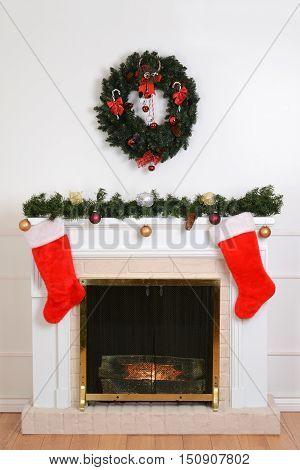 christmas fireplace with santa socks with a wreath