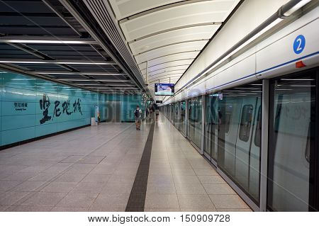 HONG KONG - OCTOBER 25, 2015: interior of The Mass Transit Railway station. MTR is the rapid transit railway system in Hong Kong. It is one of the most profitable systems in the world