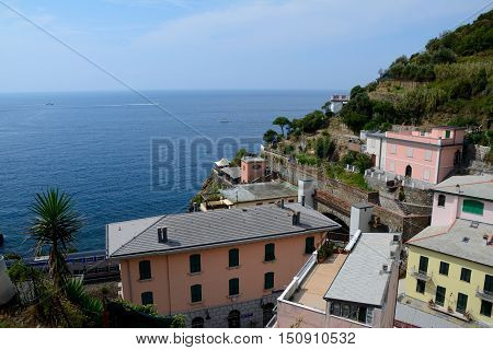 Riomaggiore Italy - September 4 2016: Buildings in Riomaggiore city in Liguria Italy. One of five Cinque Terre cities (unesco world heritage). Unidentified people visible.