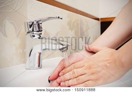 Man Washing Hands In Bathtoom