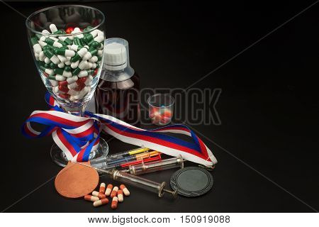 Doping in sport. Abuse of anabolic steroids for sports. Anabolic steroids spilled on a wooden table. Fraud in sports. Pharmaceutical industry. False victory.