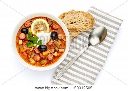 Solyanka - Russian traditional meat soup on white background