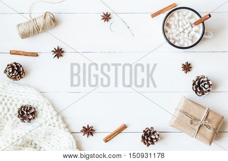 Christmas. Winter. Hot chocolate cinnamon sticks anise star marshmallow knitted blanket gift and cones. Christmas composition. Flat lay top view