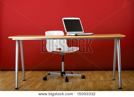 Workplace empty of people with a laptop over the desk