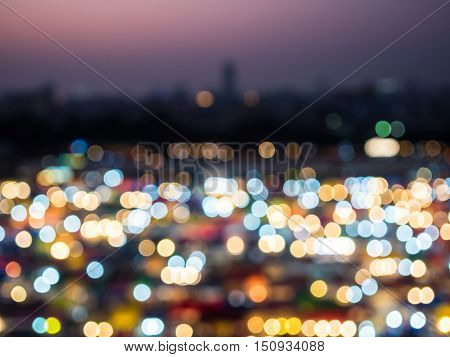 Abstract circular bokeh background of cityscape with Sunset.