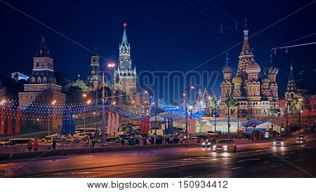 Winter night landscape in the center of Moscow. Kremlin towers St. Basil's Cathedral on Red Square