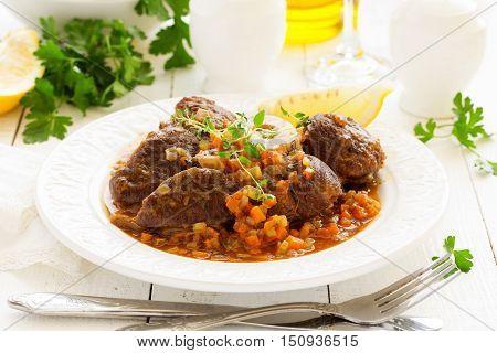 ossobuco with polenta on the Milanese. Italian Cuisine.