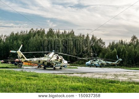 Saint-Petersburg.Russia.22 Aug 2016 .View military helicopters at the airfield in the village of Gorelovo at sunset.