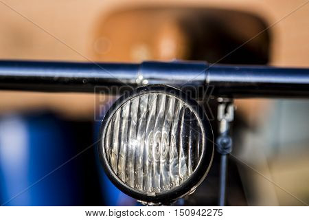 headlight of a bicycle in detail the reflected light,