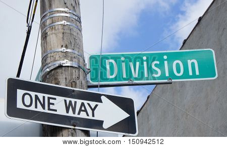 One Way Arrow and Division Street Signs