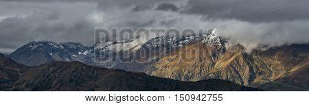 Panorama of Greater Caucasus Mountain Range. Caucasus mountains. Karachay-Cherkessia. Russia.