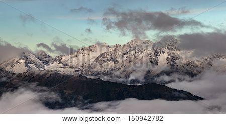 Greater Caucasus Mountain Range at sunrise. Caucasus mountains. Karachay-Cherkessia. Russia.