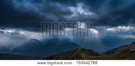 Heavy rain over mountains. View of Greater Caucasus Mountain Range from a mount Zagedan slope. Caucasus mountains. Karachay-Cherkessia. Russia.