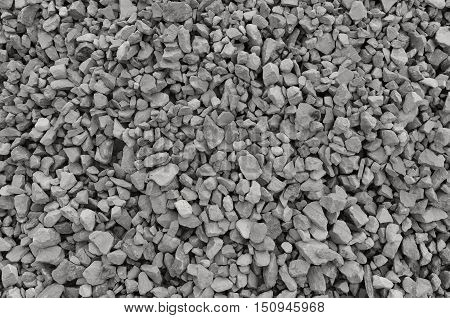 Abstract grey and beige gravel stone background crushed gray stones and granite pieces texture large detailed horizontal textured rough construction rock material mix pattern