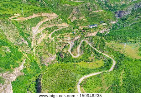 The aerial view from the Wings of Tatev cable car on the twisted mountain road between Halidzor village and Tatev Syunik Province Armenia.