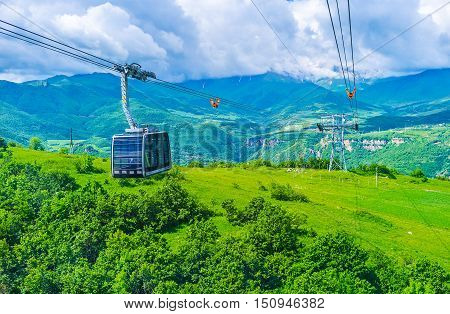 The Wings of Tatev cableway stretching from Halidzor to Tatev Monastery is officially recorded by Guinness World Records as the world's longest non-stop double track cable car Syunik Province Armenia.