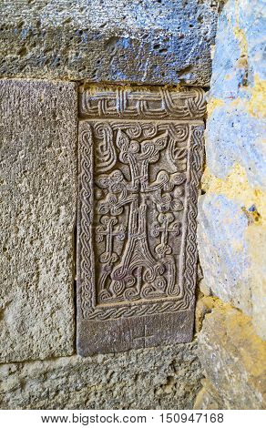 The small khachkar is hidden in corner at the Refectory of Tatev monastery Syunik Province Armenia.