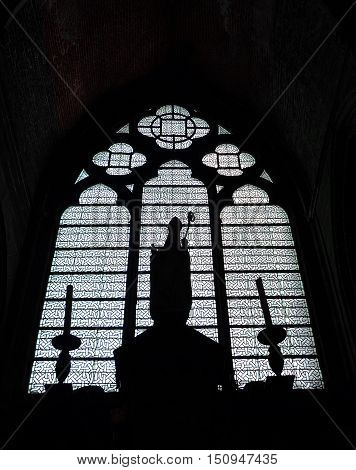 Silhouetted pretty picture inside a church (Europe)