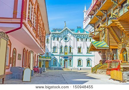 The scenic colorful mansions of different stores museums and craft centers of Izmailovsky Kremlin Moscow Russia.