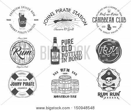 Set of vintage handcrafted emblems, labels, logos. Isolated on a white background. Sketching filled style. Pirate and sea symbols - old rum bottles, barrels, skull, pistol. Vector illustration