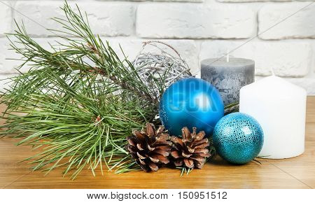 New Year 2017 composition with bright blue ball and white and grey candle