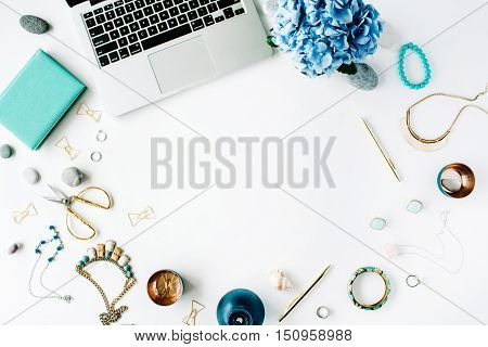 flat lay home office workspace with laptop and hydrangea on white background. top view